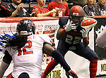 SIOUX FALLS, SD - MAY 16:  Tory Harrison #22 from the Sioux Falls Storm bobbles the ball as Brandon Clarke #12 form the Bemidji Axemen closes in during the second half of their game Saturday night at the Sioux Falls Arena. (Photo by Dave Eggen/Inertia)