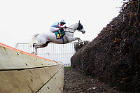 Race winner Silver Adonis ridden by Mr T Weston jumps the open ditch during the Tim Barclay Memorial Handicap Chase