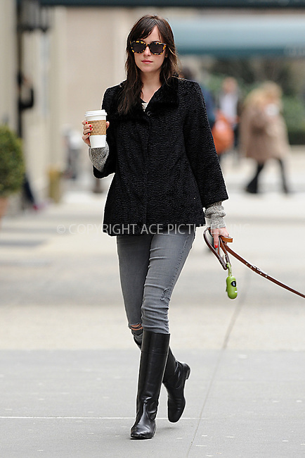 WWW.ACEPIXS.COM<br /> April 8, 2015 New York City<br /> <br /> Dakota Johnson seen walking her dog in New York City on April 8, 2015.<br /> <br /> By Line: Kristin Callahan/ACE Pictures<br /> ACE Pictures, Inc.<br /> tel: 646 769 0430<br /> Email: info@acepixs.com<br /> www.acepixs.com