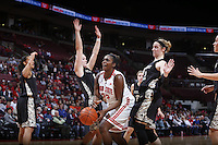 Ohio State Buckeyes center Darryce Moore (22) is fouled by Army Black Knights guard/forward Jen Hazlett (1) while guarded by Hazlett and Army Black Knights forward Olivia Schretzman (12) during the first half Friday's NCAA Division I basketball game at Value City Arena in Columbus on December 13, 2013. (Barbara J. Perenic/The Columbus Dispatch)