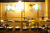 VIETNAM, Saigon, Banh Xeo An La Ghien restaurant located in Ben Than Ward, District 1, cooks prepare crepes in large woks, Ho Chi Minh City