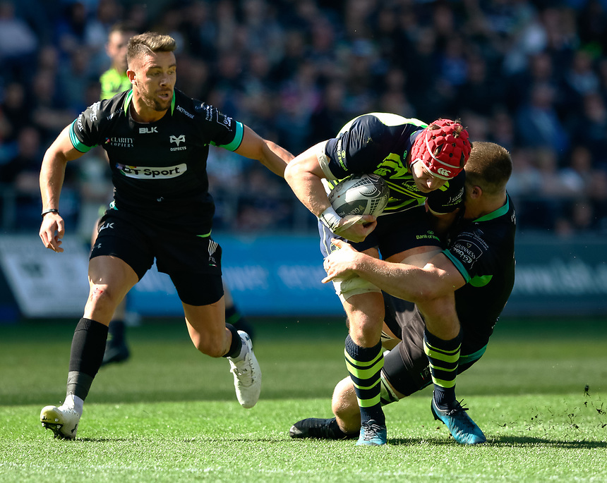 Leinster's Josh van der Flier is tackled by Ospreys' Olly Cracknell<br /> <br /> Photographer Simon King/CameraSport<br /> <br /> Guinness PRO12 Round 19 - Ospreys v Leinster Rugby - Saturday 8th April 2017 - Liberty Stadium - Swansea<br /> <br /> World Copyright &copy; 2017 CameraSport. All rights reserved. 43 Linden Ave. Countesthorpe. Leicester. England. LE8 5PG - Tel: +44 (0) 116 277 4147 - admin@camerasport.com - www.camerasport.com