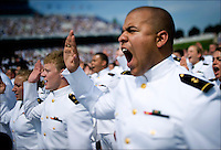Ensign Caleb Sanders is commissioned into the U.S. Navy at the U.S. Naval Academy graduation ceremony in Annapolis, Md., May 27, 2011.