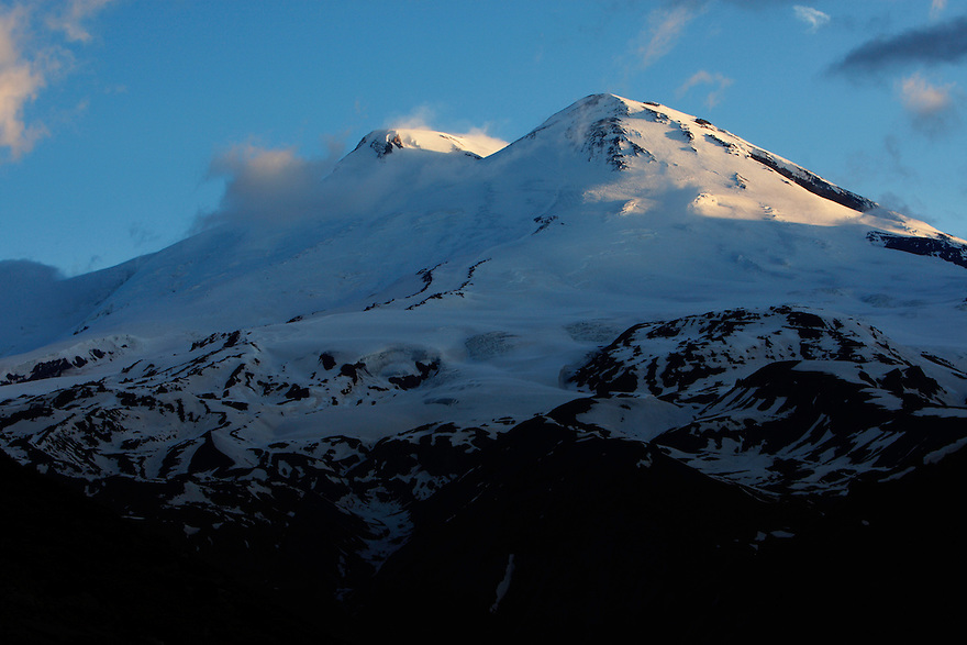 Russia, Caucasus, Mount Elbrus, highest mountain of Europe (5642 m asl), seen from Mount Cheget in the first light of the morning. The mountain has two summits, the left summit is the highest.