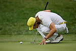 7 September 2008:   Camilo Villegas checks the path of his putt closely in the fourth and final round of play at the BMW Golf Championship at Bellerive Country Club in Town & Country, Missouri, a suburb of St. Louis, Missouri on Sunday September 7, 2008. The BMW Championship is the third event of the PGA's  Fed Ex Cup Tour.