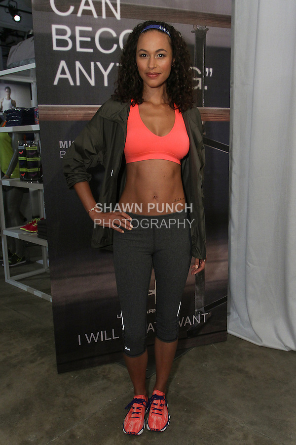 "Model poses in athletic gear during the Under Armour, ""I will what I want"" global women's campaign launch, on July 31, 2014, in New York City."