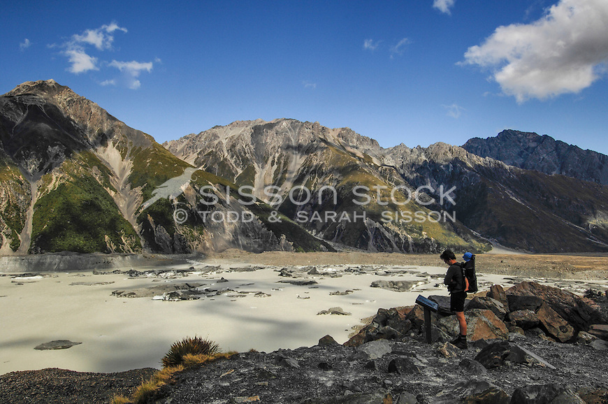 View of Tasman Glacier terminal melt lake from the Tasman Valley walking track. Man & baby in shot.