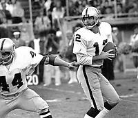 Oakland Raider quarterback Ken Stabler, with blocker Marv Hubbard..(1975 photo/Ron Riesterer)