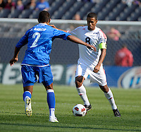 Cuba's Jaine Colomé is defended by El Salvador's Xavier Garcia.  El Salvador defeated Cuba 6-1 at the 2011 CONCACAF Gold Cup at Soldier Field in Chicago, IL on June 12, 2011.