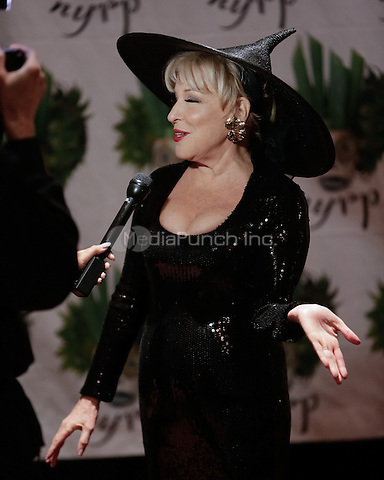"NEW YORK, NY - OCTOBER 31 : Singer and Actress Bette Midler arrives for the New York Restoration Project's 19th Annual Hulaween Gala ""FELLINI HULAWEENI"" held at the Waldorf Astoria on October 31, 2014 in New York City.  (Photo by Brent N. Clarke / MediaPunch)"