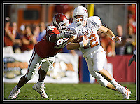 Texas quarterback Colt McCoy, right, dodges Oklahoma defender Larry Birdine, left, during the Longhorns 28-10 victory over the University of Oklahoma Sooners at the Cotton Bowl in Dallas, TX on October 6, 2006. (Brian Ray for Icon Sports Media)
