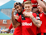 Martyn Waghorn celebrates his first penalty goal with Gedion Zelalem and Kenny Miller
