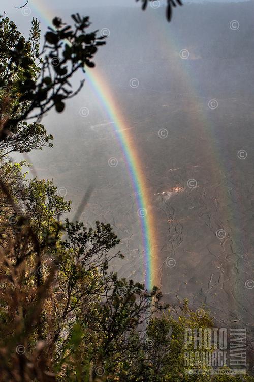 A rainbow over Kilauea Iki Crater along the Kilauea Iki trail in Hawaii Volcanoes National Park.