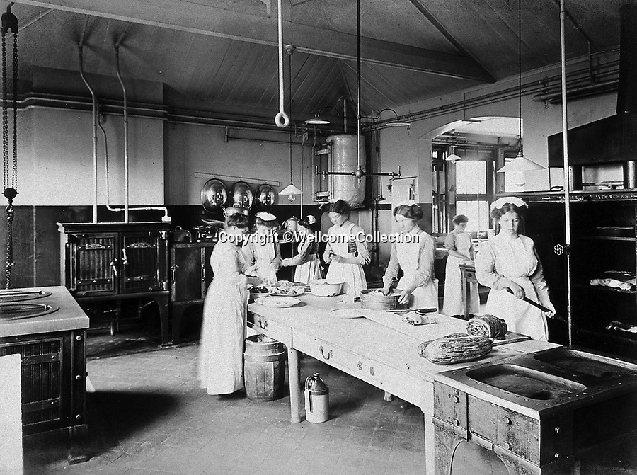 BNPS.co.uk (01202 558833)<br /> Pic: Amberley/BNPS<br /> <br /> Pictured: On top of all their other duties, nurses also had to work in the kitchens and the laundry, Holloway, London in 1912<br /> <br /> These rarely seen photos which provide a fascinating insight into British nursing in late 19th century feature in a new book.<br /> <br /> They reveal how the all-action nurses not only cared for patients but also prepared meals for them and did their laundry.<br /> <br /> Such was their ferocious work ethic, it is perhaps surprising they had time to be pictured sitting down together in the nurses dining room.<br /> <br /> One photo shows trainee nurses during a bandaging class, while another is of a busy male ward.<br /> <br /> The images are published in A History of Nursing, by former nurse Louise Wyatt who has charted the development of nursing from antiquity and the Middle Ages to the present day.