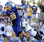 BROOKINGS, SD - AUGUST 31:  Cam Jones #85 from South Dakota State University tries to slip the grasp of Jimmy Schwabe #24 from Butler in the second quarter Saturday evening at Coughlin Alumni Stadium in Brookings. (Photo by Dave Eggen/Inertia)