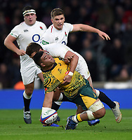 Tolu Latu of Australia looks to offload the ball after being tackled to ground by Henry Slade of England. Quilter International match between England and Australia on November 24, 2018 at Twickenham Stadium in London, England. Photo by: Patrick Khachfe / Onside Images