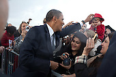 United States President Barack Obama greets people on the tarmac after arriving at Detroit Wayne Metropolitan Airport in Romulus, Michigan, October 14, 2011.  .Mandatory Credit: Pete Souza - White House via CNP