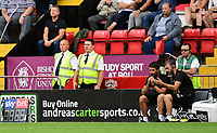 Lincoln City manager Danny Cowley, left, and Lincoln City's assistant manager Nicky Cowley discuss tactics during the game<br /> <br /> Photographer Chris Vaughan/CameraSport<br /> <br /> The EFL Sky Bet League Two - Lincoln City v Swindon Town - Saturday 11th August 2018 - Sincil Bank - Lincoln<br /> <br /> World Copyright &copy; 2018 CameraSport. All rights reserved. 43 Linden Ave. Countesthorpe. Leicester. England. LE8 5PG - Tel: +44 (0) 116 277 4147 - admin@camerasport.com - www.camerasport.com