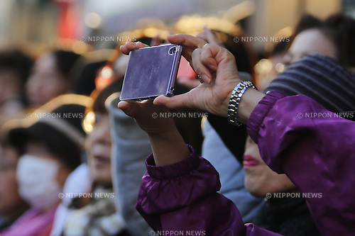 A woman takes a photo of Japan's ruling Liberal Democratic Party (LDP) lawmaker Shinjiro Koizumi with a smartphone as he delivers a speech support a candidate in Kawasaki city, Japan, on Saturday, December 13, 2014.  (Photo by Yuriko Nakao/AFLO)