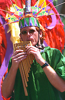 In the Heart of the Beast May Day Festival and Parade participant age 32 playing Pan's flute.  Minneapolis Minnesota USA