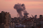Smoke rises after war crafts belonging to Israeli army carried out airstrikes over Gaza City, Gaza on November 30, 2017. Photo by Ashraf Amra