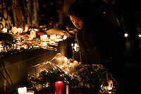 Paris, Frankrike, 15.11.2015. Francine Magtoto lives right next to Place de la Republique, and visits the square to light candles for the victims. Images from Paris in the aftermath of the devastating terror attacks on friday november 13. Photo: Christopher Olssøn.