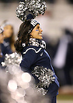 Nevada cheerleaders entertain the crowd during the first half of an NCAA college football game against Fresno State in Reno, Nev., on Saturday, Nov. 22, 2014. Fresno State won 40-20. (AP Photo/Cathleen Allison)