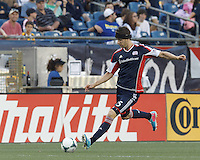 New England Revolution defender Stephen McCarthy (15) passes the ball.  In a Major League Soccer (MLS) match, the New England Revolution (blue) tied D.C. United (white), 0-0, at Gillette Stadium on June 8, 2013.