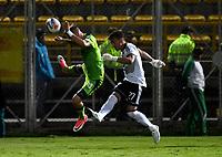 BOGOTA - COLOMBIA -25 - 11 - 2017: Jean Carlo Blanco  (Izq.) portero de La Equidad disputa el balón con Nicolas Vikonis (Der.) jugador de Millonarios, durante partido de ida entre La Equidad y Millonarios, de los cuartos de final la Liga Aguila II - 2017, jugado en el estadio Metropolitano de Techo de la ciudad de Bogota. / Jean Carlo Blanco  (L) player of La Equidad vies for the ball with Nicolas Vikonis (R) goalkeeper of Millonarios, during a match for the first leg between La Equidad and Millonarios, to the quarter of finals for the Liga Aguila II - 2017 at the Metropolitano de Techo Stadium in Bogota city, Photo: VizzorImage  / Luis Ramirez / Staff.