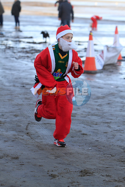 The Great Santa 3k and Santa's little helpers run in Bettystown on Sunday 7th December 2014.<br /> Picture:  Thos Caffrey / www.newsfile.ie