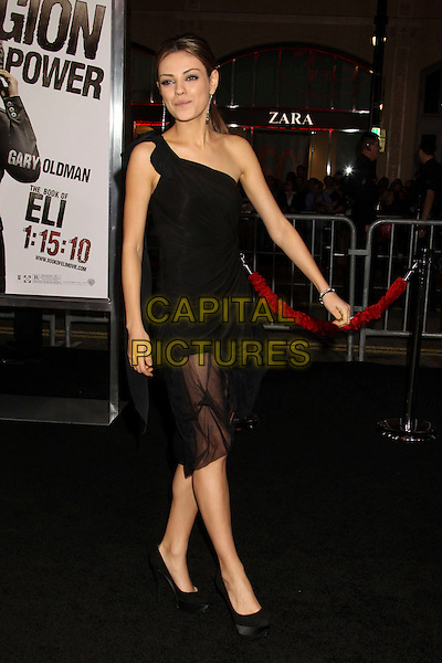 "MILA KUNIS.""The Book Of Eli"" Los Angeles Premiere held at Grauman's Chinese Theatre, Hollywood, California, USA..January 11th, 2009.full length dress black one shoulder ruched sheer layered layers platform shoes.CAP/ADM/MJ.©Michael Jade/AdMedia/Capital Pictures."