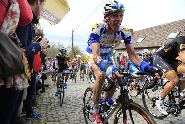 The peleton, including Tim Declercq (BEL) Topsport Vlaanderen-Baloise, climb the Molenberg during the 2014 Tour of Flanders, Belgium.<br /> Picture: Eoin Clarke www.newsfile.ie