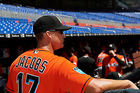 Miami Marlins Mike Jacobs (17) in the dugout before a Florida Instructional League game against the Washington Nationals on September 26, 2018 at the Marlins Park in Miami, Florida.  (Mike Janes/Four Seam Images)