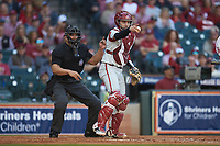 Arkansas Razorbacks catcher Casey Opitz (12) asks the first base umpire for help as home plate umpire Michael Banks looks on during the game against the Oklahoma Sooners in game two of the 2020 Shriners Hospitals for Children College Classic at Minute Maid Park on February 28, 2020 in Houston, Texas. The Sooners defeated the Razorbacks 6-3. (Brian Westerholt/Four Seam Images)