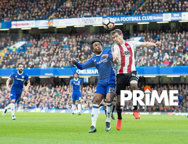Brentford Andreas Bjelland and Chelsea's William during the FA Cup 4th round match between Chelsea and Brentford at Stamford Bridge, London, England on 28 January 2017. Photo by PRiME Media Images / Andrew Aleksiejczuk.