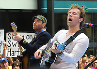 Chris Martin and Jonny Buckland of Coldplay perform at the Today Show Summer Concert Series at Rockefeller Plaza , NYC (06-27-08)