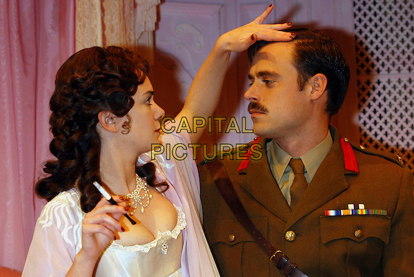 "VICTORIA HAMILTON & JAMIE THEAKSTON.Attend photocall for ""Home & Beauty"" at the Lyric Theatre, London, UK..October 18th, 2002.half length cleavage uniform hand cleavage touching profile.CAP/PL.©Phil Loftus/Capital Pictures"