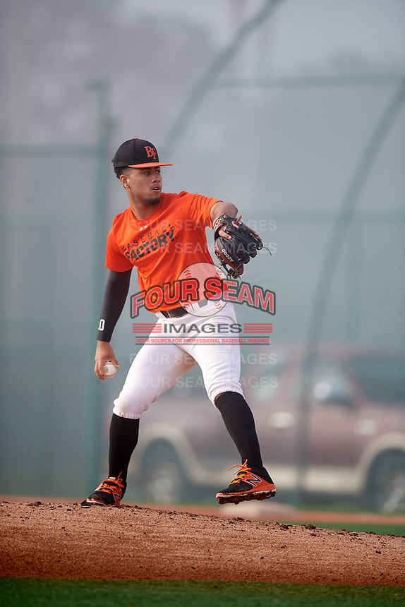 Bryson Mitchell (58) of Alexandria, Virginia during the Baseball Factory Pirate City Christmas Camp & Tournament on December 30, 2018 at Pirate City in Bradenton, Florida. (Mike Janes/Four Seam Images)