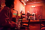 Ona's Music Room located in Pepper Place, a converted Dr. Pepper plant on 2nd. Ave. South in Birmingham, Alabama.  Ona's features live music Wednesday through Saturday.  The venue is owned by musician Ona Watson.  Pictured here is singer Ashley Roberts backed by her husband Steve and other members of the jazz band.