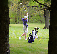 Stoughton's Henry Klongland hits after a drop out of the rough during boys high school golf on Wednesday, 5/15/13, at House on the Rock / The Springs Golf Course in Spring Green, Wisconsin