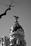 A winged figure tops an ornate building on La Gran Via in Madrid, Spain. Feb. 22, 2009.