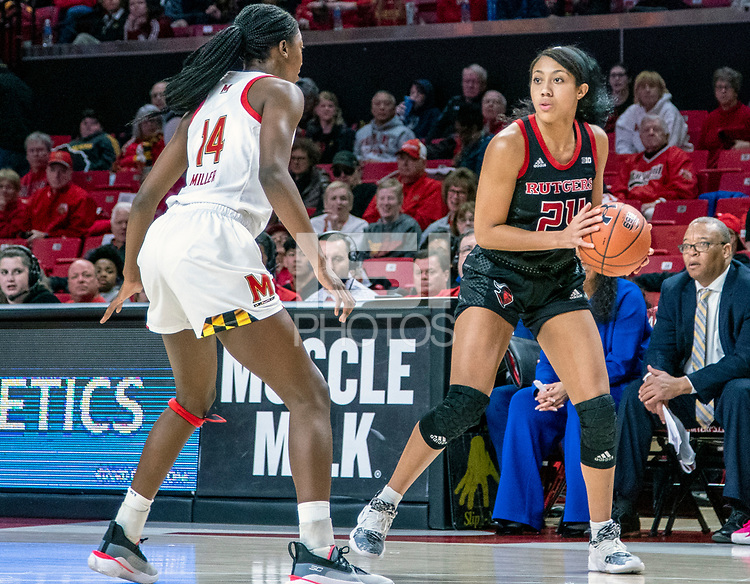 COLLEGE PARK, MD - FEBRUARY 9: Diamond Miller #14 of Maryland checks Arella Guirantes #24 of Rutgers during a game between Rutgers and Maryland at Xfinity Center on February 9, 2020 in College Park, Maryland.