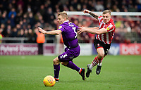 Lincoln City's Harry Anderson vies for possession with Grimsby Town's Sebastian Ring<br /> <br /> Photographer Chris Vaughan/CameraSport<br /> <br /> The EFL Sky Bet League Two - Lincoln City v Grimsby Town - Saturday 19 January 2019 - Sincil Bank - Lincoln<br /> <br /> World Copyright © 2019 CameraSport. All rights reserved. 43 Linden Ave. Countesthorpe. Leicester. England. LE8 5PG - Tel: +44 (0) 116 277 4147 - admin@camerasport.com - www.camerasport.com