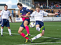Morton's David McNeil and Forfar's Darren Dods challenge for the ball.