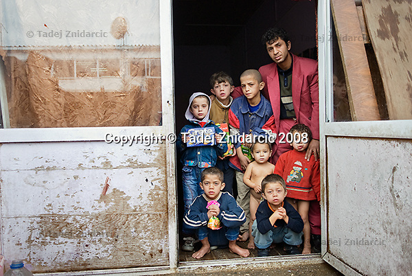 Muhamed and his sons in front of their home in Osterode IDP camp in northern Mitrovica. Muhamed's wife died a few years ago and the situation of his family is one of the worst in the camp. His brother who also lives in the camp with his family helps Muhamed get by.