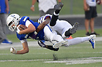 Columbia's Jackson Holmes (left) is tackled by Mascoutah's Tylor McDonell. Columbia played Mascoutah on Saturday August 31, 2019 in a football game that was never started on Friday night due to bad storms.<br /> Tim Vizer/Special to STLhighschoolsports.com