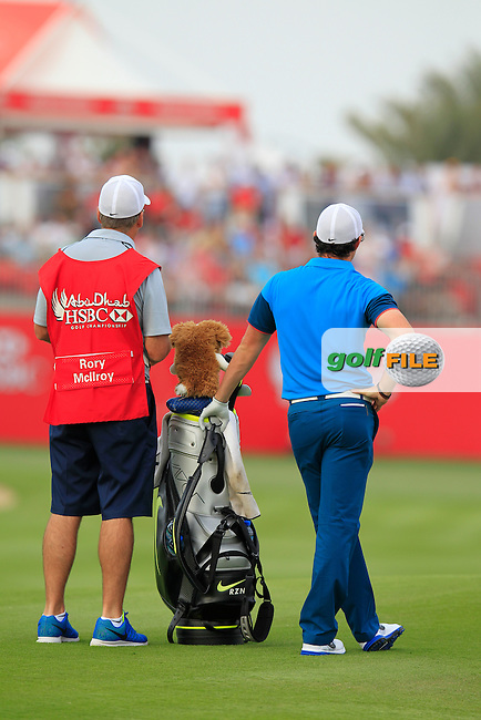 Rory McIlroy (NIR) and caddy J.P.Fitzgerald wait on the 17th hole during Sunday's Final Round of the Abu Dhabi HSBC Golf Championship 2015 held at the Abu Dhabi Golf Course, United Arab Emirates. 18th January 2015.<br /> Picture: Eoin Clarke www.golffile.ie