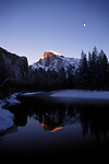 CA: Yosemite National Park, Moon and Half Dome in winter, reflections in Merced River     Photo Copyright: Lee Foster, lee@fostertravel.com, www.fostertravel.com, (510) 549-2202.cayose204