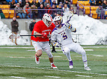 University at Albany Men's Lacrosse defeats Cornell 11-9 on Mar 4 at Casey Stadium.  Connor Fields (#5) defended by Jake Pulver (#34).