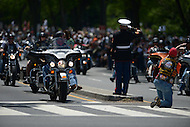 Washington, DC - May 25, 2014: Former Marine SSgt. Tim Chambers salutes as thousands of motorcycles participate in Rolling Thunder May 25, 2014, in remembrance and honor of military veterans and fallen soldiers.  (Photo by Don Baxter/Media Images International)